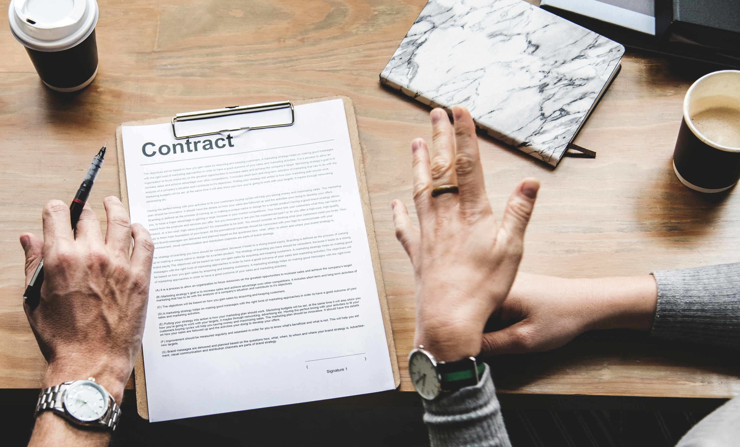 unsplash-rawpixel-658247-hands-contract